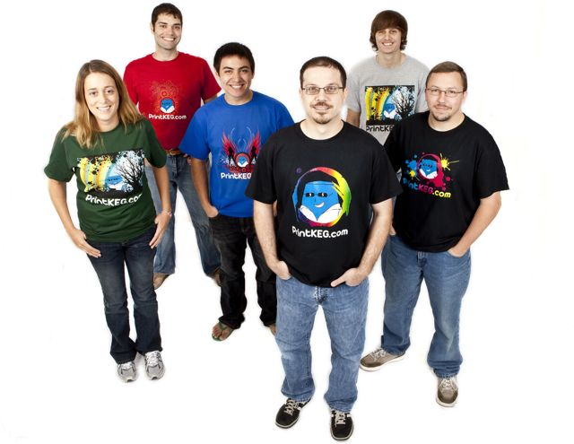 Our staff showing off color shirt printing