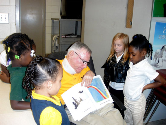 Mr. White with Children reading his book