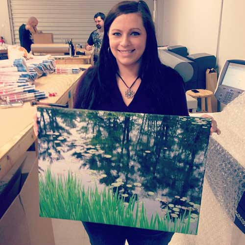 Jessica holding a wrapped canvas print
