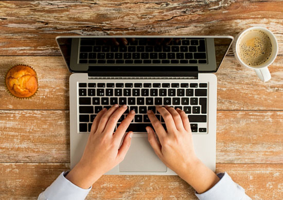 Picture of woman hands with laptop purchased at Canva