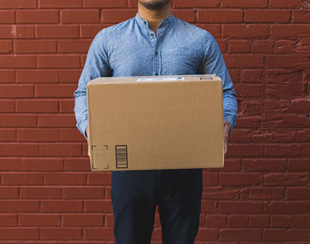 Shipping delivery person holding box